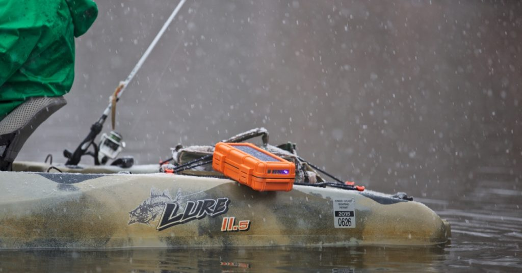 kayaking with the orange RokPak Pioneer Series