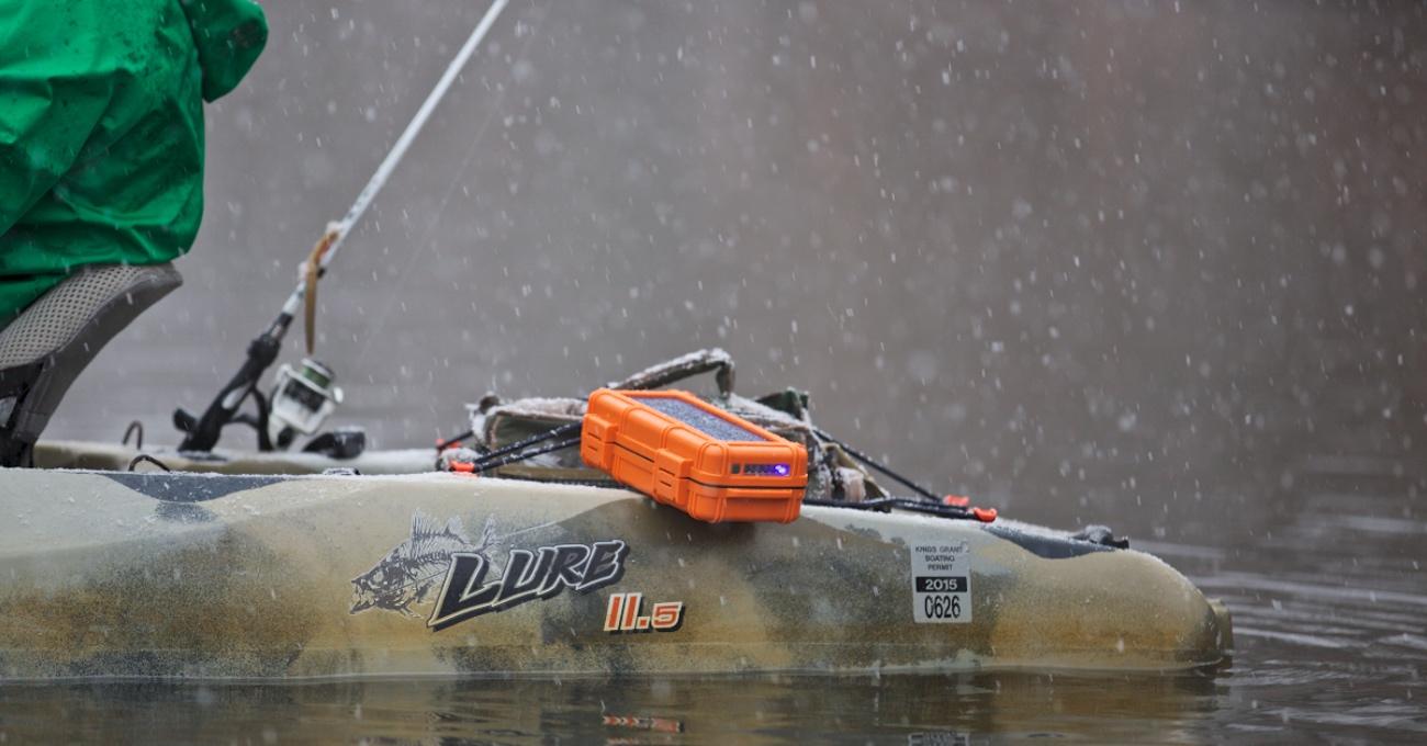 kayaking with the orange RokPak Pioneer Series