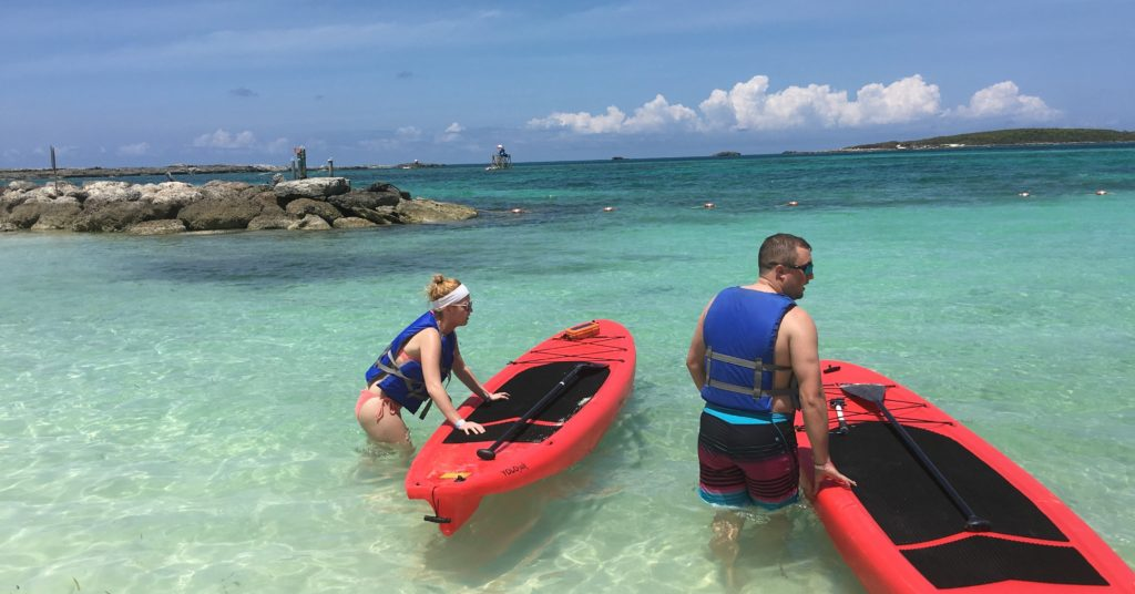 Paddle boarders using RokPak Pioneer Series in the Bahamas